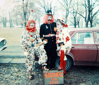 Marilyn Exline, a.k.a. Miss Happy, right, her husband, Jim, a.k.a. Clancy the cop, and an unidentified clown get ready to sell bloomers.