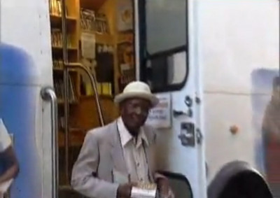 Sylvester Cooper leaves the Elyria Public Library's Bookmobile with a cookbook in hand in 2008.