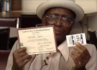 Sylvester Cooper shows off his Laubach Way to Reading Diploma during a 2008 Elyria Public Library commercial about its Project Read literacy program.