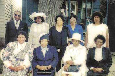 Sylvester Cooper and his eight sisters, pictured in the late 1980s. Front row, from left: Lettuce Currie, Louise Dickson, Sarah Morris, Lossie Mae Watkins. Back row, from left: Sylvester, Beatrice Friend, Eliza Bell White, Sarah Major Lee and Rosa Lee Wright.
