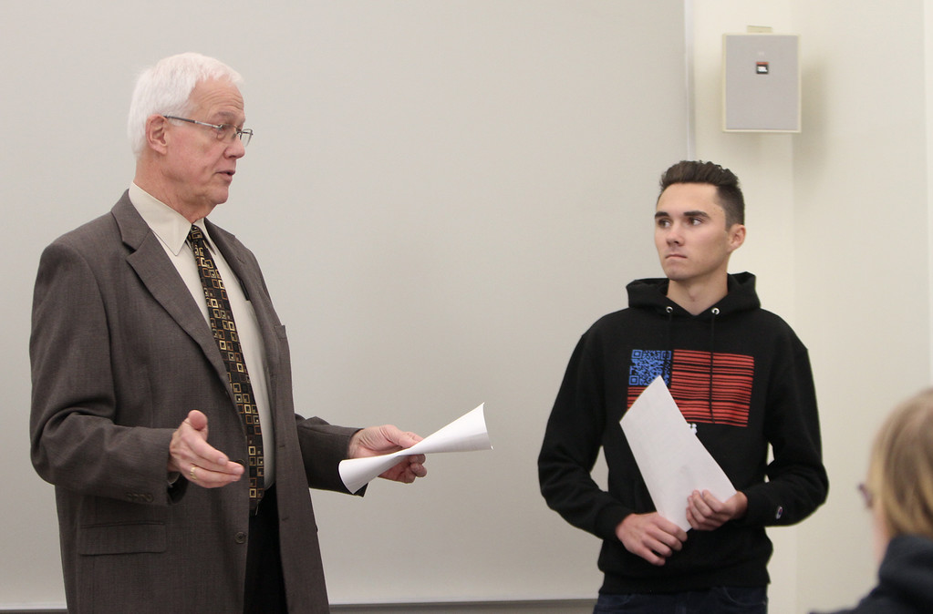 . Professor of Criminal Justice Ron Brevard introduces Parkland shooting survivor David Hogg to speak to his class, Interpersonal Communications in Criminal Justice, at Middlesex Community College.  (SUN/Julia Malakie)