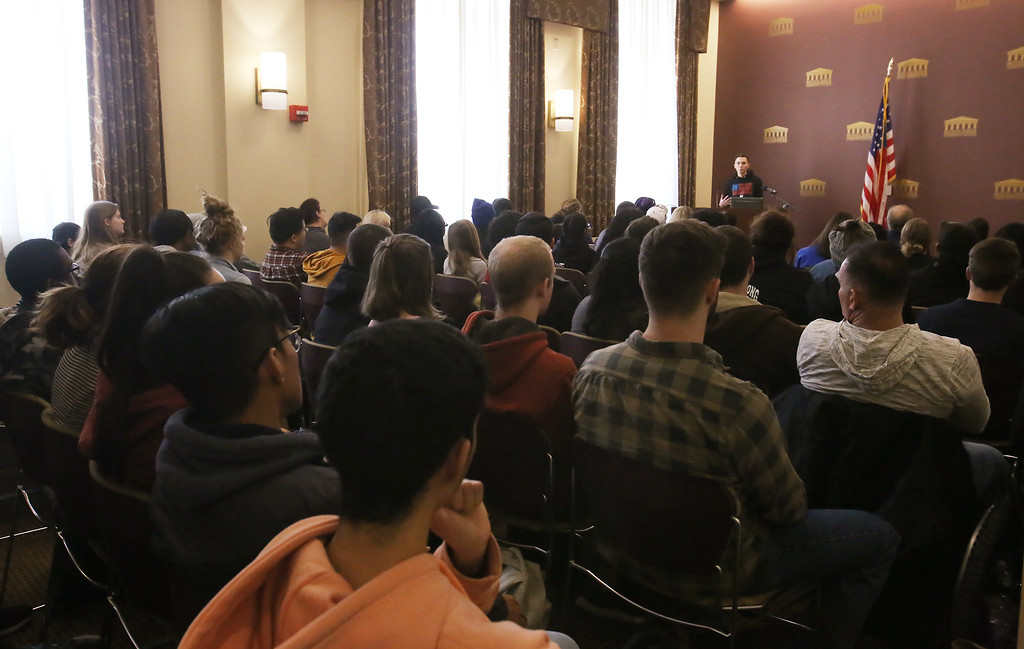 . Parkland shooting survivor David Hogg speaks to a group of students, staff and guests, at Middlesex Community College.  (SUN/Julia Malakie)