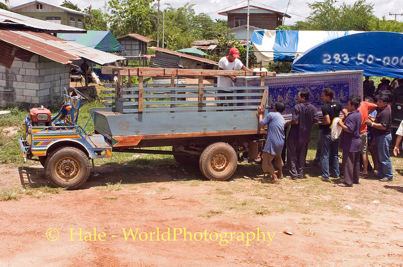 Tahsang Villagers Loading Refrigerated Box Containing Coffin on to Farm Truck in Isaan Region of Thailand