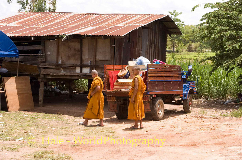 Deceased Lao Loum Woman's Possessions Loaded onto Farm Wagon Outside of Her Home in Isaan Region of Thailand