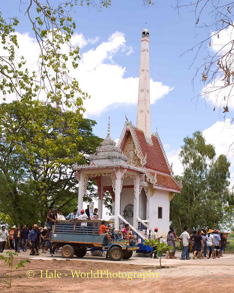 Farm Truck Carrying the Coffin Circumambulates the Local Wat One of Three Times