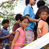 Young Villagers Climbing Crematorium Stairway On Their Way to Pay Their Last Respects, Isaan Region of Thailand