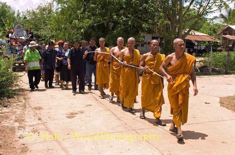 Monks Leading Funeral Procession From House Through Village to the Local Wat, Isaan Region of Thailand