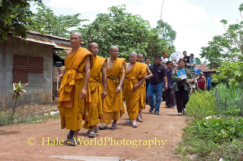 Monks (Two sons, two grandsons, and a nephew)Leading Funeral Procession From House Through Village to the Local Wat, Isaan Region of Thailand