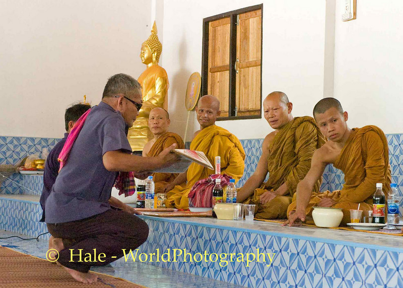 Relative Making Merit by Making Offering to Monks As Part of Buddhist Funeral Rites