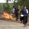 Deceased Village Woman's Favorite Possessions Being Burned Outside of Crematorium at Local Wat