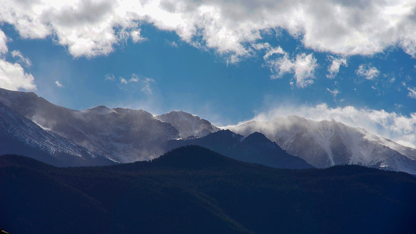 Blowing snow on Pike's Peak and surrounding mountains.