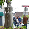 "A plaque dedicated to former Fitchburg Mayor Alfred Wollacott, was moved for the placement of the ""The Immigrant"", a statue which was placed in 2013. Descendants of Wollacott met with Economic Director Jerry Beck Saturday morning to discuss featuring the plaque in a more prominent place on Main Street. SENTINEL & ENTERPRISE / Ashley Green"