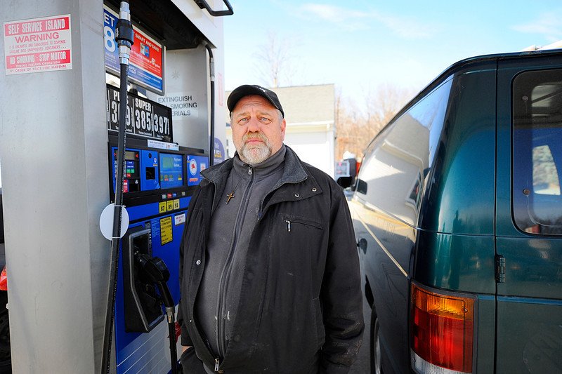 Doug Leger of Leominster, who drives a van for his job, talks about the upcoming increase in gas prices as he stops to put gas in his vehicle at the Mr. Mike's Mobil station on Main St. in Leominster, Tuesday.<br /> SENTINEL & ENTERPRISE / BRETT CRAWFORD