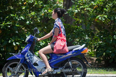 Young Woman Riding Motor Bike - Rarotonga, Cook Islands, Polynesia, Oceania