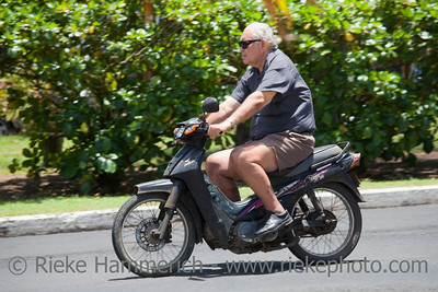 Senior Man Riding Motorbike - Rarotonga, Cook Islands, Polynesia, Oceania
