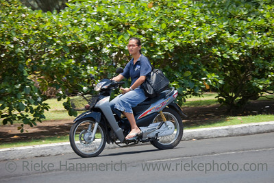 Woman Riding Motorbike - Rarotonga, Cook Islands, Polynesia, Oceania