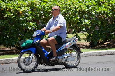 Man Riding Motor Bike - Rarotonga, Cook Islands, Polynesia, Oceania