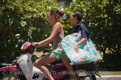 Young Women Riding Motorbike - Rarotonga, Cook Islands, Polynesia, Oceania