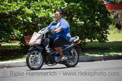 Mature Woman Riding Motorbike - Rarotonga, Cook Islands, Polynesia, Oceania