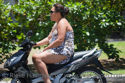 Young Woman Riding Motorbike - Rarotonga, Cook Islands, Polynesia, Oceania