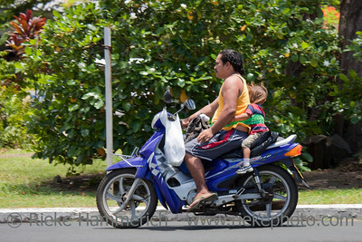 Father and Daughter Riding Motor Bike - Rarotonga, Cook Islands, Polynesia, Oceania