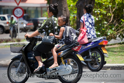 Mother and Daughter Riding Motor Bike - Rarotonga, Cook Islands, Polynesia, Oceania