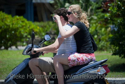 Young Couple Riding Motor Scooter - Rarotonga, Cook Islands, Polynesia, Oceania