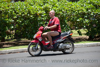 Bald Man Riding Motor Bike - Rarotonga, Cook Islands, Polynesia, Oceania