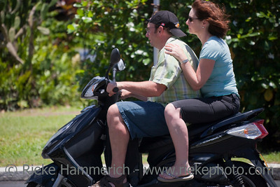 Mature Couple Riding Motor Scooter - Rarotonga, Cook Islands, Polynesia, Oceania