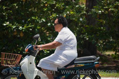 Aged Woman Riding Motorbike - Rarotonga, Cook Islands, Polynesia, Oceania