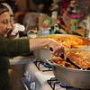 Dolores Cruzado, 73, of Lowell, prepares pork at home for a fresh batch of Christmas pasteles.
