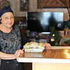 Dolores Cruzado, 73, of Lowell, with a fresh batch of her Christmas pasteles.