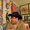 Globe/Roger Nomer<br /> Charlie Lewis enjoys the music and company at Cowboy Bob's on a recent Saturday night in Asbury. Lewis runs the karaoke at Cowboy Bob's on Friday nights.