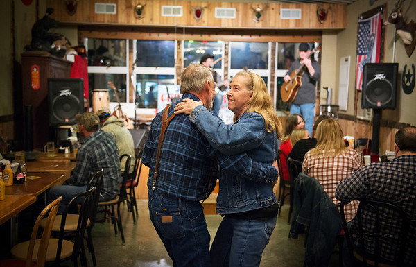 Globe/Roger Nomer<br /> Tom and Nancy Ulmer, Pittsburg, take a turn on the dance floor at Cowboy Bob's on a recent Saturday night.