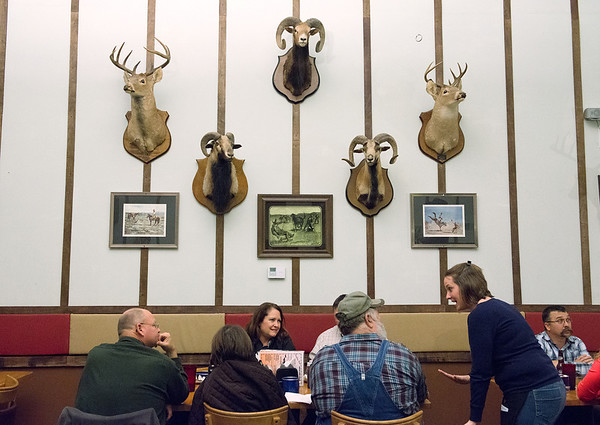 Globe/Roger Nomer<br /> Becky Peavler excitedly chats with a table of customers during a busy night at Cowboy Bob's in Asbury, Mo. on Feb. 15, 2014. Cowboy Bob's functions as the main gathering place in Asbury.