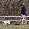 Dracut features. David Tamulynas of Tyngsboro walks with his bichon mix, Oreo, 8, at Dillon-McAnespie Park in Dracut. (SUN/Julia Malakie)