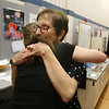 Richardson Middle School music teacher Robin Mallory, who is retiring from Dracut Public Schools at the end of this school year, hugs 8th grader Alyson Archambault after their last string orchestra class of the year. (SUN/Julia Malakie)