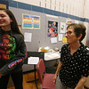 Richardson Middle School music teacher Robin Mallory, who is retiring from Dracut Public Schools at the end of this school year, says goodbye to 8th grader Isabella Rocha after their last string orchestra class of the year. (SUN/Julia Malakie)