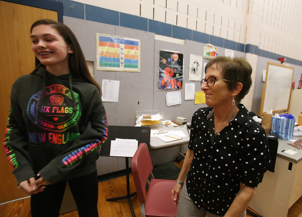 . Richardson Middle School music teacher Robin Mallory, who is retiring from Dracut Public Schools at the end of this school year, says goodbye to 8th grader Isabella Rocha after their last string orchestra class of the year. (SUN/Julia Malakie)