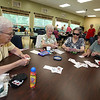 "Lunch, card games and tai chi at the Dracut Council on Aging, which will be preparing seniors for the 2020 U.S. Census. Playing ""5/15"" from left: Peggy Beauregard, Mildred Brown, Jade Choy and Cynthia McMahon, all of Dracut. (SUN/Julia Malakie)"