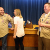 Older brothers Michael Chidester, 33, of Somerville, left, and Matthew, 35, of Austin, Texas, right, put on their own Boy Scout univorm shirts, but Matthew decided his was too tight to fit. At center is their sister, Stephanie Chidester, of Lehigh, Utah. (SUN/Julia Malakie)