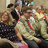 Twin brothers Adam, right, and Benjamin Chidester, second from right, of Townsend, with their oldest brother Matthew, 35, of Austin, Texas, left, and their mother Laura Chidester, await the start of the ceremony where they were awarded the rank of Eagle Scout, following their five older brothers, at Littleton Chapel in Littleton. (SUN/Julia Malakie)
