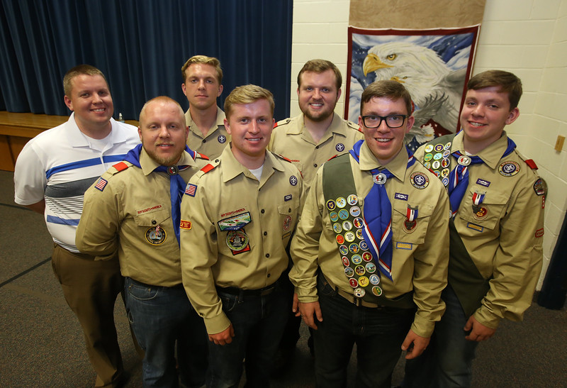 Twin brothers Adam and Benjamin Chidester, of Townsend, are awarded the rank of Eagle Scout, folloing their five older brothers, at a ceremony at Littleton Chapel in Littleton. From left, Matthew, 35, of Austin, Texas, Michael, 33, of Somerville, Kevin, 23, a senior at Brigham Young University-Idaho, Aaron, 20, a freshman at BYU-Idaho, Brian, 28, of Brighton, and twins Benjamin and Adam Chidester, 18, North Middlesex Regional H.S. '16, who will both be going to BYU-Idaho (Benjamin may do a mission first). (SUN/Julia Malakie)