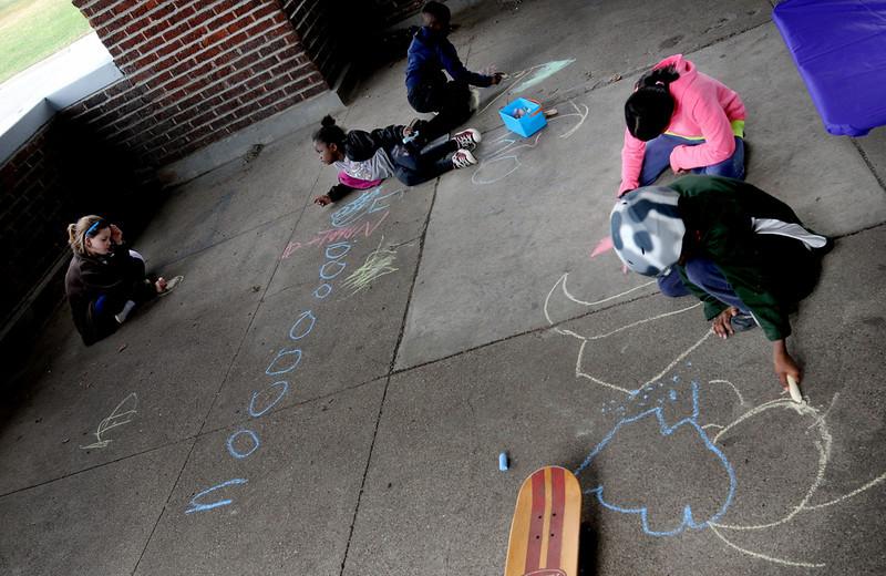 Neighborhood children enjoy writing with chalk inside a picnic shelter at Indian Mounds Regional Park. (Pioneer Press: Sherri LaRose-Chiglo)
