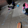 Neighborhood children enjoy writing with chalk inside a picnic shelter at Indian Mounds Regional Park. (Pioneer Press: Sherri LaRose-Chiglo)