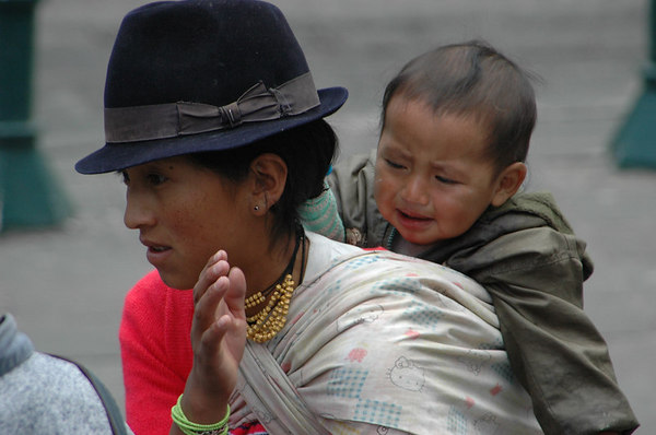 Crying baby with Mom<br /> La Catedral, Quito