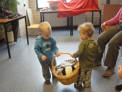The toddlers help to put away all the props each time.