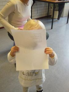 Elise reading the lyrics to the song we learnt today