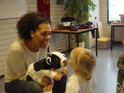 The class starts with Roger the bull, who everyone gets to kiss or hug