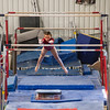 Elizabeth on the practice bars, Trevino's Gymnastics District Qualifier (Sep. 2013)